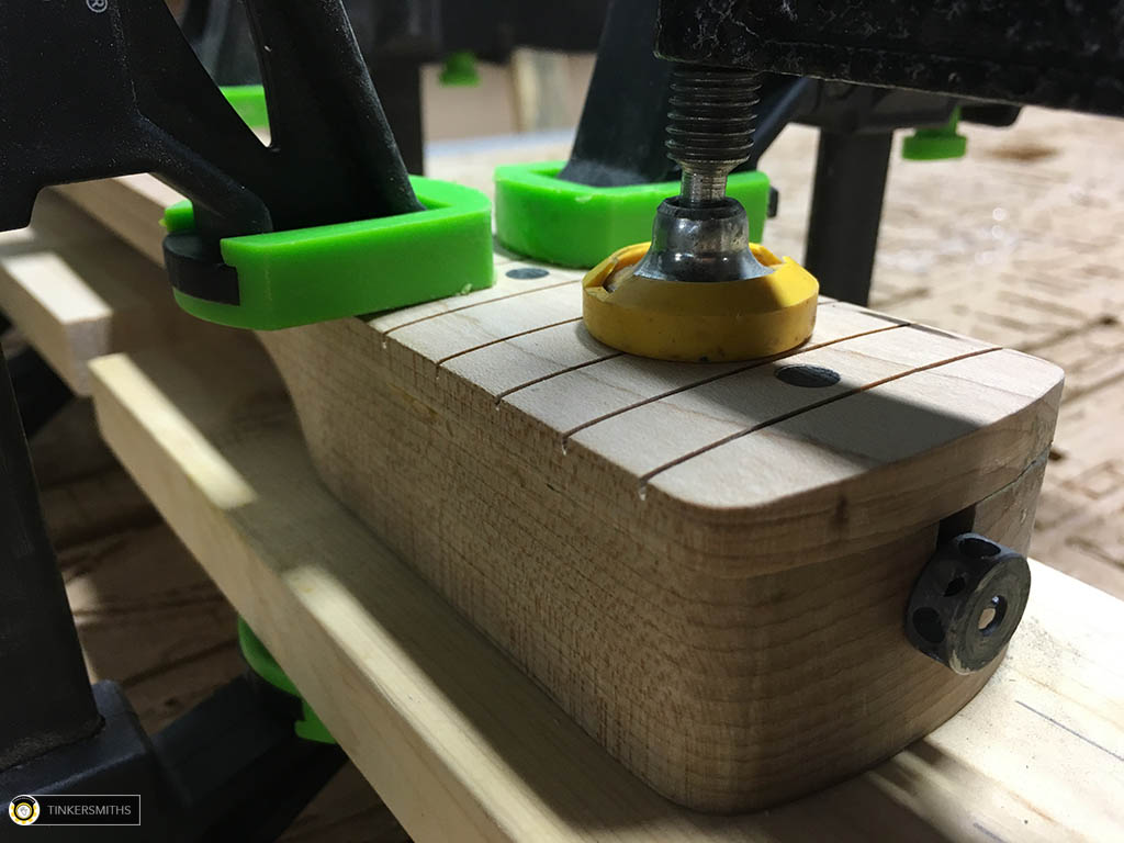 Closeup of Fret bar Grooves in this Guitar Neck Fret Board Gluing